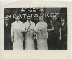 Apple family posed outside of Apple's Meat Market: Sam Apple, Henry Apple, Joe Apple, unidentified friend, Lou Apple, and unidentified friend (l. to r.)