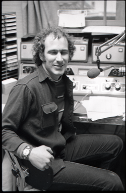 Informal portrait of Richard Safft in radio broadcast studio, linking to the digital object