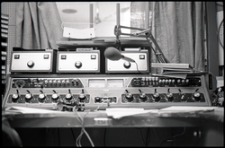 Control board in radio broadcast studio, linking to the digital object