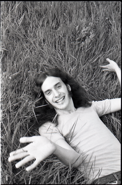 Informal portrait of Ron Cobleigh lying in the grass (Warwick, Mass.), linking to the digital object