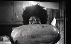 Sylvia Jordan with watermelon in commune kitchen (Warwick, Mass.), linking to the digital object
