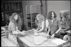 Marleen McCarty, Julie Howard, and Sammy Wolf kneading dough in commune bakery (Warwick, Mass.), linking to the digital object