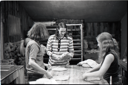Sammy Wolf, Nick Carson, and Julie Howard (l. to r.) working in commune bakery (Warwick, Mass.), linking to the digital object