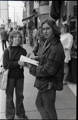 Julie Howard and Jon Haber distributing Free Spirit Press magazine on the streets (Springfield, Mass.), linking to the digital object