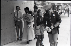 Julie Howard distributing Free Spirit Press magazine to police officer on the streets (Springfield, Mass.), linking to the digital object