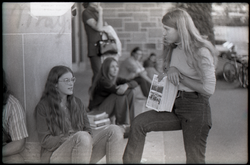 Irene White (with bent leg) distributing copies of Free Spirit Press (Springfield, Mass.), linking to the digital object