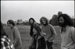 Free Spirit Press crew walking in a field (Springfield, Mass.), linking to the digital object