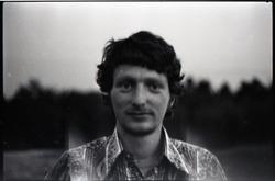 Mike Scanlon (commune member), standing in a field (Warwick, Mass.)