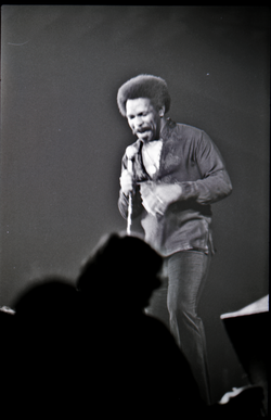 Richard Nader's Rock and Roll Revival concert at the Springfield Civic Center: Lloyd Price with microphone facing the audience (Springfield, Mass.), linking to the digital object