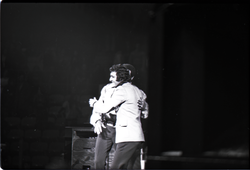 Richard Nader's Rock and Roll Revival concert at the Springfield Civic Center: Nader embracing Chubby Checker on stage (Springfield, Mass.), linking to the digital object