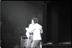 Richard Nader's Rock and Roll Revival concert at the Springfield Civic Center: Chubby Checker embracing Richard Nader at end of his performance (Springfield, Mass.), linking to the digital object