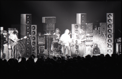Grateful Dead concert at Springfield Civic Center: band in performance in front of a wall of speakers (Springfield, Mass.), linking to the digital object