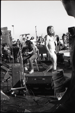 Hollywood Speedway Rock Festival: Wet Willie in performance, naked man walking across stage blissfully (Pembroke Pines, Fla.), linking to the digital object