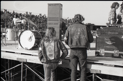 Hollywood Speedway Rock Festival: James Baker and unidentified colleague (l. to r.) at concert stage, both wearing Spirit in Flesh jackets (Pembroke Pines, Fla.), linking to the digital object