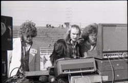 Hollywood Speedway Rock Festival: three men working at the mixing board (Pembroke Pines, Fla.), linking to the digital object