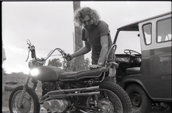 Man working on a motorcycle (Pembroke Pines, Fla.), linking to the digital object