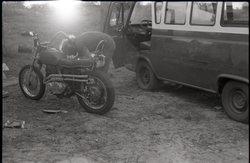 Man working on motorcycle (Pembroke Pines, Fla.), linking to the digital object