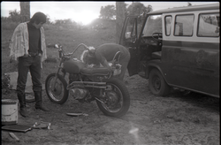 Two men working on motorcycle (Pembroke Pines, Fla.), linking to the digital object