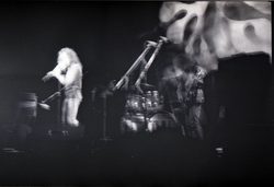 Jethro Tull in concert at the Springfield Civic Center: blurry image of Ian Anderson (on flute) (Springfield, Mass.), linking to the digital object