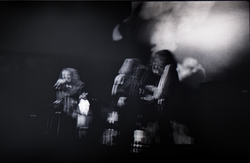 Jethro Tull in concert at the Springfield Civic Center: blurry image of Ian Anderson (left) and bandmates (Springfield, Mass.), linking to the digital object