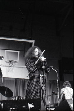 Jethro Tull in concert at the Springfield Civic Center: Ian Anderson at microphone with flute (Springfield, Mass.), linking to the digital object
