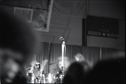 Jethro Tull in concert at the Springfield Civic Center: blurry shot of heads of audience and band behind (Springfield, Mass.), linking to the digital object