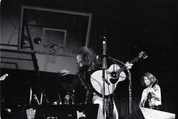 Jethro Tull in concert at the Springfield Civic Center: Ian Anderson playing acoustic guitar, Martin Barre in background (Springfield, Mass.), linking to the digital object