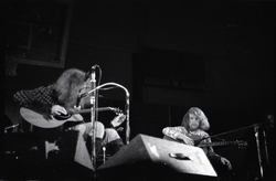 Jethro Tull in concert at the Springfield Civic Center: Ian Anderson and Martin Barre (l. to r.), seated with guitars (Springfield, Mass.), linking to the digital object