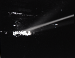 Santana concert at the Springfield Civic Center: distant view of band in performance lit by spotlight (Springfield, Mass.), linking to the digital object