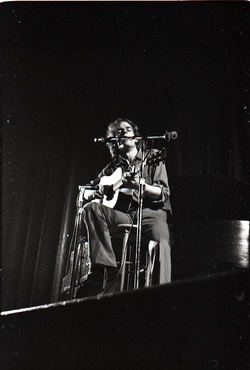 Livingston Taylor in concert: Taylor playing acoustic guitar (Springfield, Mass.), linking to the digital object
