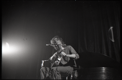 Livingston Taylor in concert: Taylor tuning his guitar (Springfield, Mass.), linking to the digital object