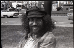 Portrait of Randy Kleinrock, long hair and hat (Greenfield, Mass.), linking to the digital object