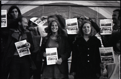 Free Spirit Press crew standing by bus, clutching issues of the magazine (Greenfield, Mass.), linking to the digital object