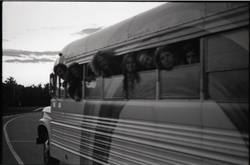 Free Spirit Press crew peering out bus windows (Greenfield, Mass.), linking to the digital object
