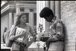 Irene White distributing Free Spirit Press magazine to young man in front of Springfield City Hall (Springfield, Mass.), linking to the digital object