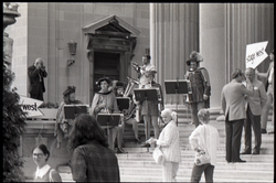 Costumed musical performance on steps of Springfield City Hall (Springfield, Mass.), linking to the digital object