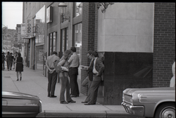 Free Spirit Press crew hawking their magazine to businessmen on the streets (Springfield, Mass.), linking to the digital object
