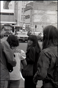 Young people on street in front of Steigers Department Store (Springfield, Mass.), linking to the digital object