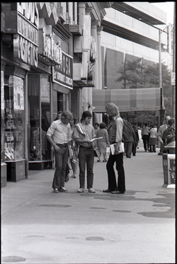 Free Spirit Press crew distributing their magazine on the street (Springfield, Mass.), linking to the digital object
