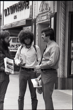 Free Spirit Press crew distributing their magazine on the street near M.J. Kittredge jewelry store (Springfield, Mass.), linking to the digital object