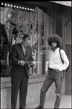 Middle-aged man in suit looking at Free Spirit Press magazine (Springfield, Mass.), linking to the digital object