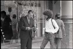 Free Spirit Press crew member discussing the magazine with a man in a business suit (Springfield, Mass.), linking to the digital object