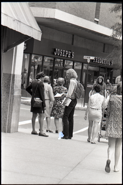 Free Spirit Press crew member handing out magazine on a street corner (Springfield, Mass.), linking to the digital object