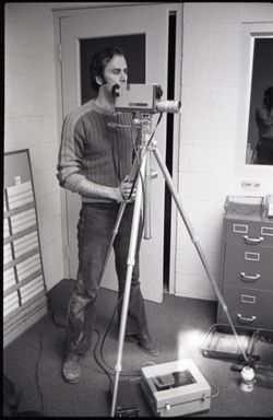 Peter Harris with video camera (Bennington, Vt.), linking to the digital object