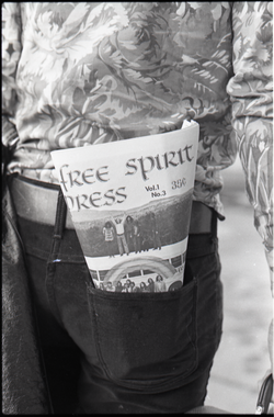 Close-up of Free Spirit Press (vol. 1, 4) in Tom Frank's rear pocket (Greenfield, Mass.), linking to the digital object