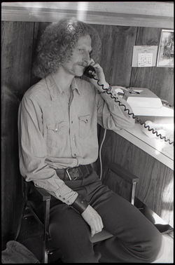 Gordon Adams on the phone in the Free Spirit Press office (Greenfield, Mass.), linking to the digital object