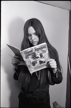 Heidi Bushell reading a copy of Free Spirit Press (vol. 1, 4) , linking to the digital object