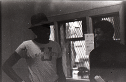 Two unidentified men (one in UMass Amherst t-shirt) in the UMass Student Union (Amherst, Mass.), linking to the digital object