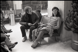 Richard Safft talking to person waiting at JFK airport (New York, N.Y.), linking to the digital object