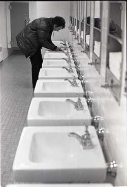 Richard Safft in bathroom at JFK airport (New York, N.Y.), linking to the digital object
